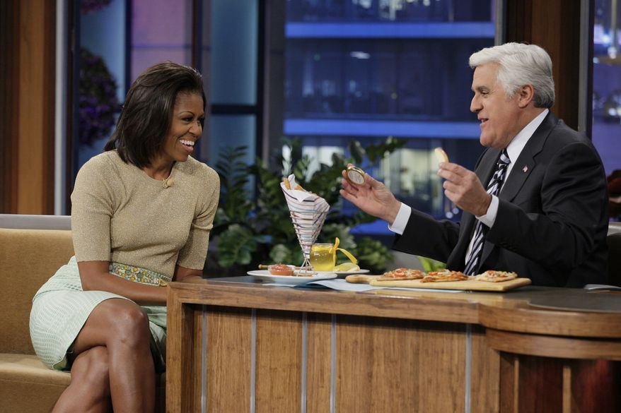 """First lady Michelle Obama appears with host Jay Leno on """"The Tonight Show With Jay Leno"""" in Burbank, Calif., on Tuesday, Jan. 31, 2012. (AP Photo/NBC, Stacie McChesney)"""