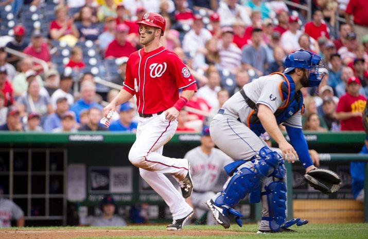 Washington Nationals Bryce Harper scores on a Ryan Zimmerman RBI single bottom of the third inning. (Rod Lamkey Jr./The Washington Times)