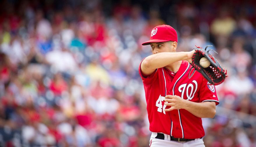 Washington Nationals pitcher Gio Gonzalez takes a breath on the mound in between batters in the top of the fifth inning. (Rod Lamkey Jr./The Washington Times)