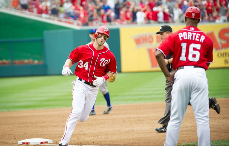 Washington Nationals Bryce Harper makes his way around third base after his solo home run in the bottom of the fifth inning. The Nationals defeated the Mets 5-2. (Rod Lamkey Jr./The Washington Times)