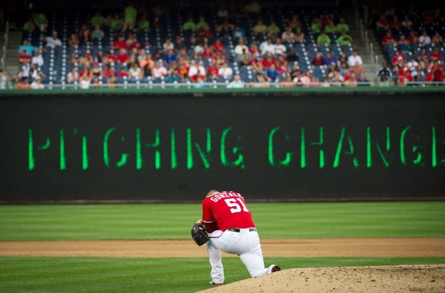 Washington Nationals relief pitcher Michael Gonzalez takes a quiet moment to himself on the mound before pitching in the top of the eighth inning. (Rod Lamkey Jr./The Washington Times)