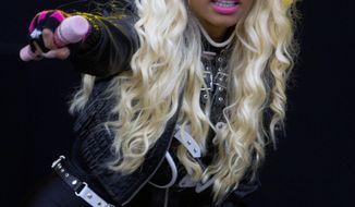 Singer-rapper Nicki Minaj performs at the Radio One Hackney Music Festival in Hackney Marshes in east London on Saturday, June 23, 2012. (AP Photo/Joel Ryan)