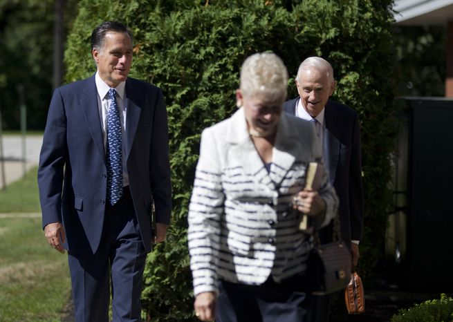 Republican presidential candidate Mitt Romney (left) walks toward the Church of Jesus Christ of Latter-day Saints with two unidentified people on Sunday, Aug. 19, 2012, in Wolfeboro, N.H. (AP Photo/Evan Vucci)