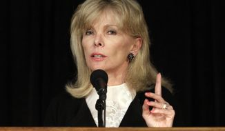 Financier Darla Moore speaks to students at the University of South Carolina in Columbia, S.C., in March 2011. (AP Photo/Brett Flashnick)