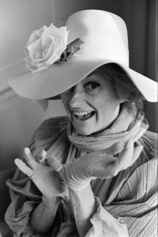 In this in this March 18, 1966 file photo, comedian Phyllis Diller models one of her 300 hats in Hollywood, Calif. Diller, the housewife turned humorist who aimed some of her sharpest barbs at herself, died Monday, Aug. 20, 2012, at age 95 in Los Angeles. (AP Photo/File)