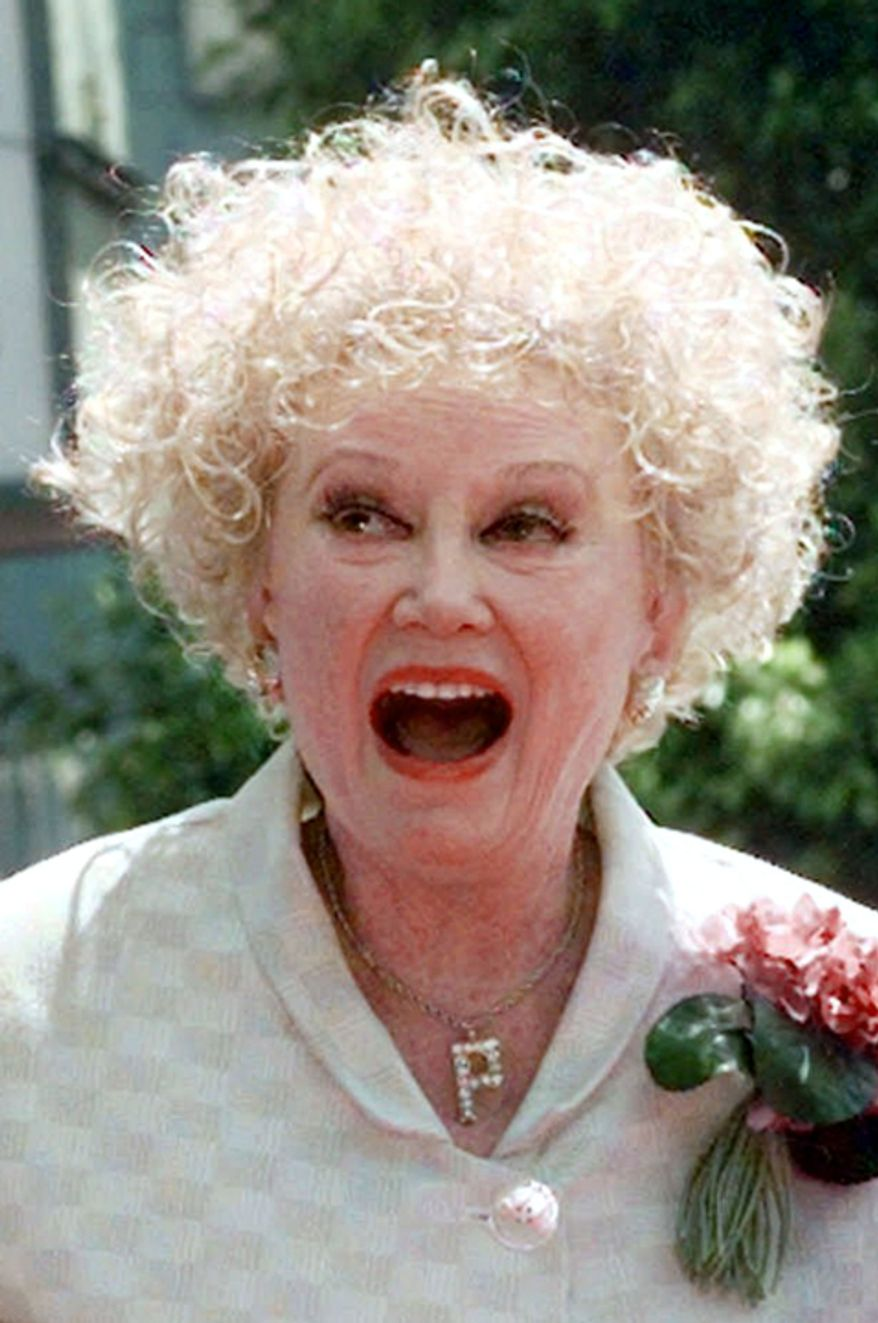 In this May 17, 1999 file photo, Phyllis Diller laughs in the Hollywood section of Los Angeles.  (AP Photo/Nick Ut, File)