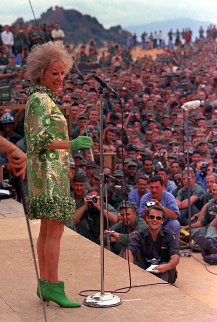 In this Jan. 6, 1967 file photo, comedian Phyllis Diller performs during the Bob Hope show for American troops at Can Ranh Bay, South Vietnam.  (AP Photo/File)