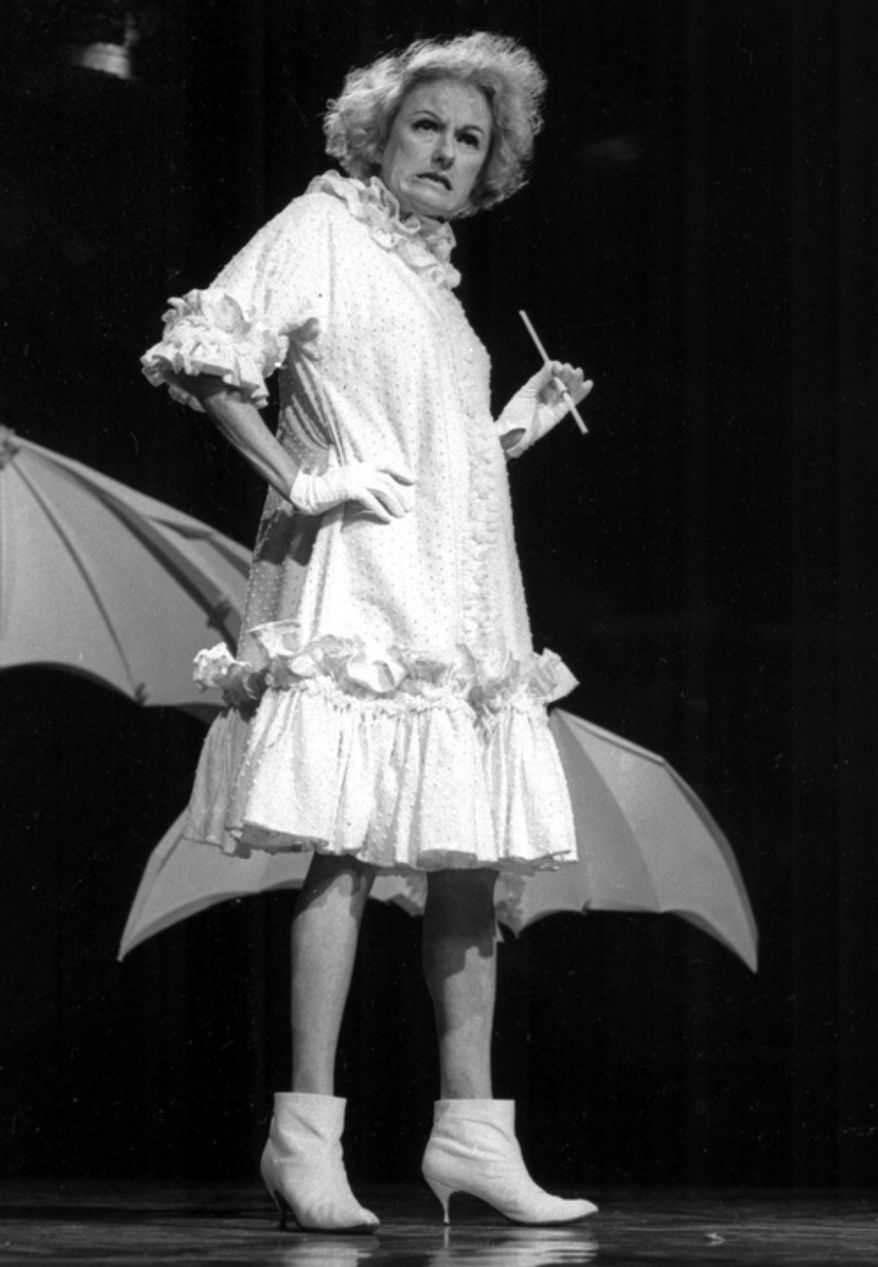In this undated file photo, Comedian Phyllis Diller performs in character. Diller, the housewife turned humorist who aimed some of her sharpest barbs at herself, died Monday, Aug. 20, 2012, at age 95 in Los Angeles. (AP Photo/NBC-TV, File)