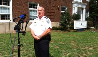 First District Cmdr. Daniel Hickson of the Metropolitan Police Department briefs reporters on a violent assault early Saturday in the Capitol Hill neighborhood (Andrea Noble/The Washington Times)