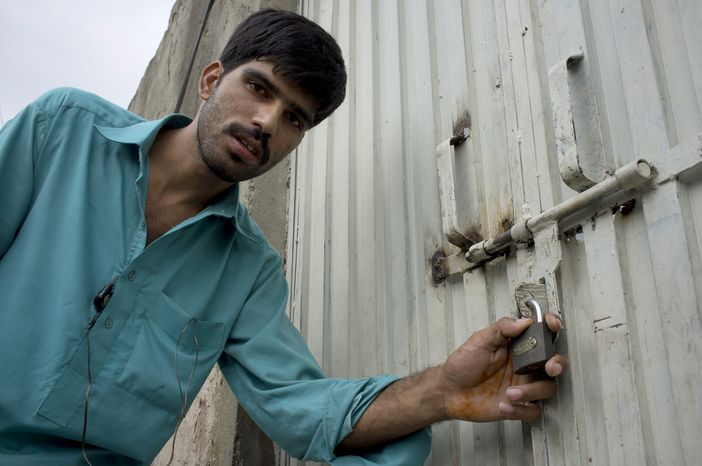 Mukhtar Khan, a neighbor of an arrested Christian girl, shows the locked house of the girl's family and vowed never to allow them to live in this neighborhood, a suburb of Islamabad, Pakistan, on Monday, Aug. 20, 2012.  (AP Photo/B.K. Bangash)