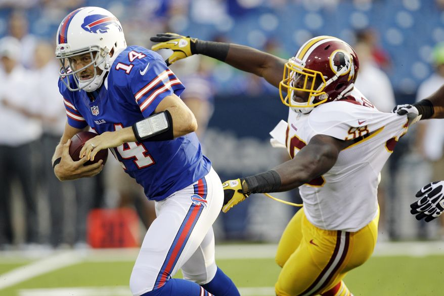 Buffalo Bills quarterback Ryan Fitzpatrick (14) is pressured by Washington Redskins linebacker Brian Orakpo (98) during the first quarter of a preseason NFL football game in Orchard Park, N.Y., Thursday, Aug. 9, 2012. (AP Photo/David Duprey)
