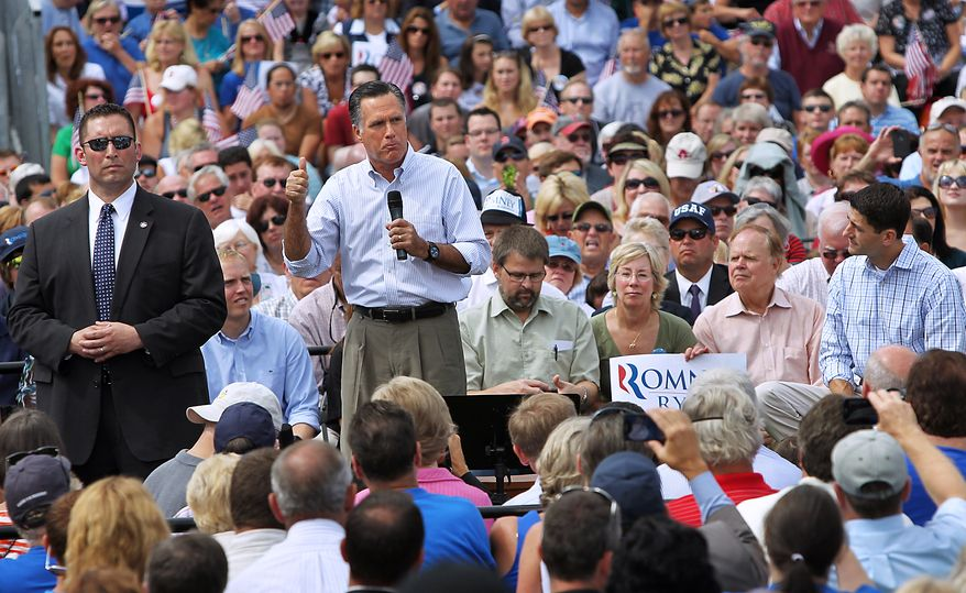 Rep. Paul Ryan (right), the Republican presidential running mate, listens at right as GOP presidential candidate Mitt Romney makes a point during a town-hall-style campaign event at St. Anselm College in Manchester, N.H., on Monday, Aug. 20, 2012. (AP Photo/Cheryl Senter)