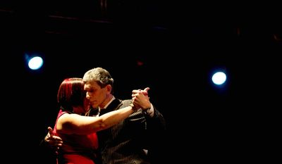 A couple competes during the Tango Dance World Cup 2012, salon category,  in Buenos Aires, Argentina. Hundreds of professional dancers compete in the championship and teach many the eight basic steps of the dance in the city where it was born. (AP Photo/Natacha Pisarenko)