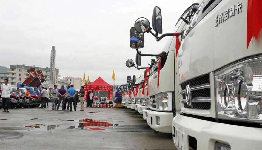 Trucks are exhibited Monday at the Rason International Trade Fair in North Korea. The Stalinist country is staging its second such trade fair in the special economic zone of Rason this week just days after a top North Korean official went to China to drum up support for the region. (Associated Press)