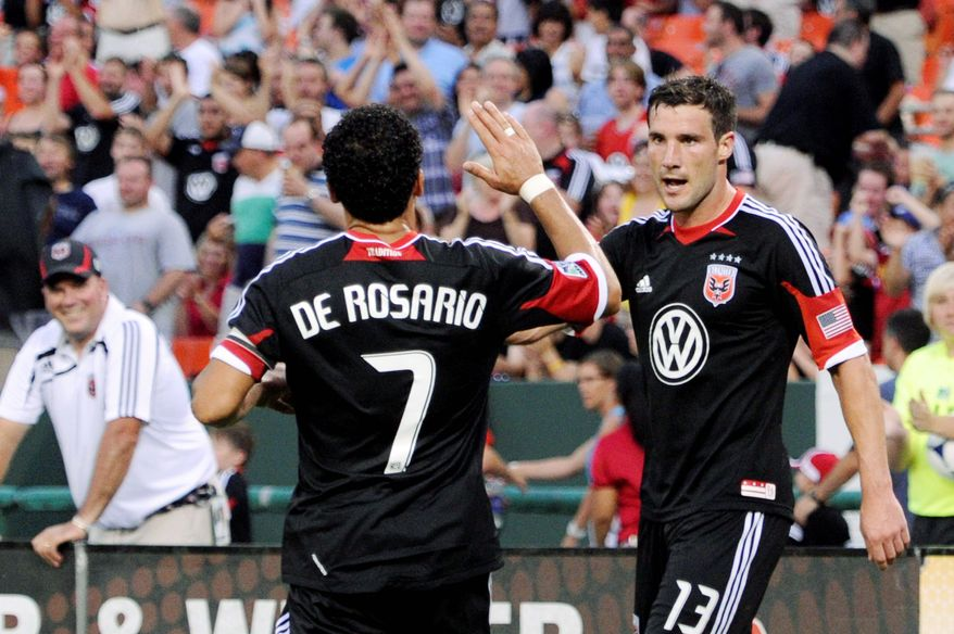 D.C. United's Dwayne De Rosario congratulates Chris Pontius on his first half goal at RFK Stadium in Washington, D.C., on Saturday, June 30, 2012. (Preston Keres/Special to The Washington Times)
