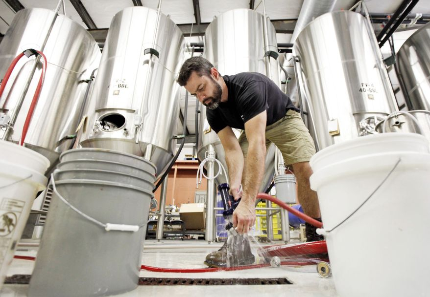 Head brewer Brian Nelson cleans equipment at Hardywood Park Craft Brewery in Richmond, which opened last October. It is part of a trend growing throughout the state, which has about 40 craft breweries. The Travel Channel has listed Virginia among seven top beer destinations. (Associated Press)