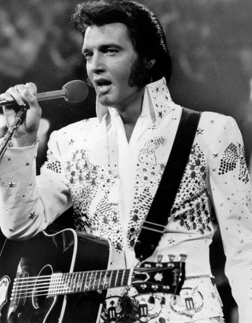 NBC-TV broadcast Elvis Presley in concert during the latter part of his career. Presley died on Aug. 16, 1977, but his estate has announced it has authorized holograms of his performances to be produced to mimic live appearances. (NBC-TV via Associated Press)