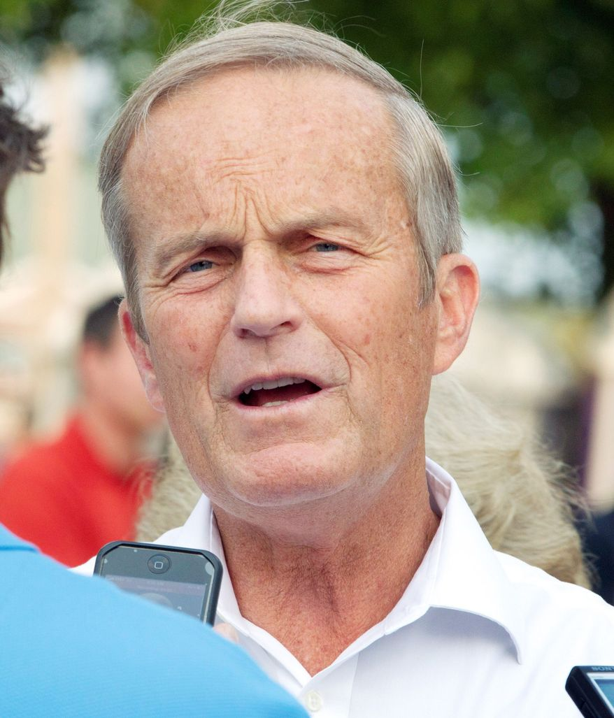Rep. W. Todd Akin, Missouri Republican, talks with reporters about his Senate candidacy. He has apologized for insensitive remarks about rape but the Republican Party still wants him to drop out of the race. (Associated Press)