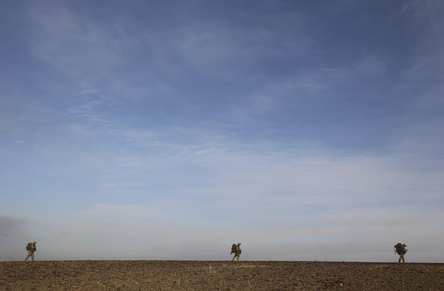 **FILE** U.S. Marines patrol outside Marjah, in Afghanistan's Helmand province, in February 2010. (Associated Press)