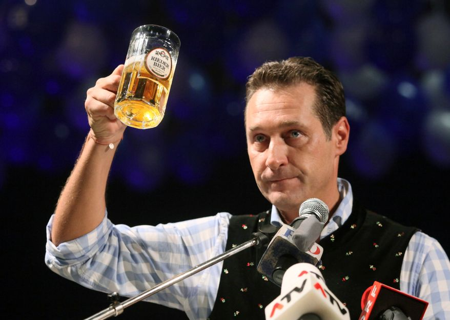 Heinz-Christian Strache, head of the Austrian right-wing Freedom Party, lifts a mug of beer during his traditional Ash Wednesday speech in Ried, Austria, on Wednesday, Feb. 22, 2012. (AP Photo/dapd, Rudolf Brandstaetter)