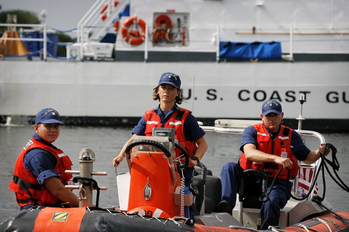 From left, United States Coast Guard Seaman John Zegarra, Boatswain's Mate 2nd Class Tesse Wilson and Chief Petty Officer Shawn Hansen demonstrate an 18' Zodiac inflatable boat in downtown Tampa, Fla., on Tuesday, Aug. 7, 2012. The Hillsborough County Sheriff's Office, Tampa Police department, United States Coast Guard and the the Florida Fish and Wildlife Conservation Commission displayed vessels they will use to secure waterways during the Republican National Convention in Tampa in a special event open only to the media. (AP Photo/The Tampa Bay Times, Edmund D. Fountain)