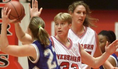 In a Dec. 12, 1999 photo, Nebraska's Charlie Rogers (33), guards Creighton's Corey Sweeney (22) during a women's basketball match in Lincoln, Neb. Rogers, who told police she was the victim of a vicious hate crime in July, 2012, was charged with making a false report Tuesday, Aug. 21, 2012 and pleaded not guilty to the misdemeanor charge. Authorities issued an arrest warrant for Rogers Tuesday morning. (AP Photo/Lincoln Journal Star, William Lauer)