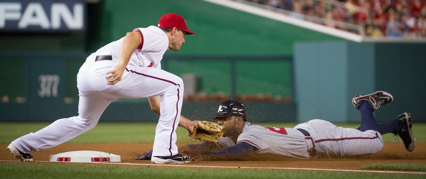 Atlanta Braves OF Jason Heyward is caught stealing Aug. 20, 2012, by Washington Nationals 3B Ryan Zimmerman in the first inning of the Nationals' 5-4, 13-inning home victory. (Rod Lamkey Jr./The Washington Times)