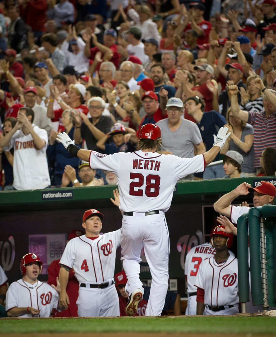 Washington Nationals OF Jayson Werth is greeted at the dugout after scoring on Bryce Harper's RBI single in the first inning of the Nationals' 5-4, 13-inning home victory over the Atlanta Braves on Aug. 20, 2012. (Rod Lamkey Jr./The Washington Times)