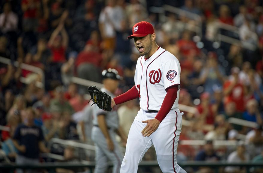 Washington Nationals relief pitcher Michael Gonzalez celebrates after sending the game into the bottom of the 11th inning in the Nationals' 5-4, 13-inning home victory over the Atlanta Braves on Aug. 20, 2012. (Rod Lamkey Jr./The Washington Times)