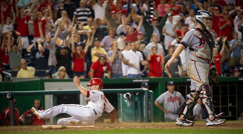 Washington Nationals 2B Danny Espinosa scores on Chad Tracy's game-winning RBI single in the Nationals' 5-4, 13-inning home victory over the Atlanta Braves on Aug. 20, 2012. (Rod Lamkey Jr./The Washington Times)