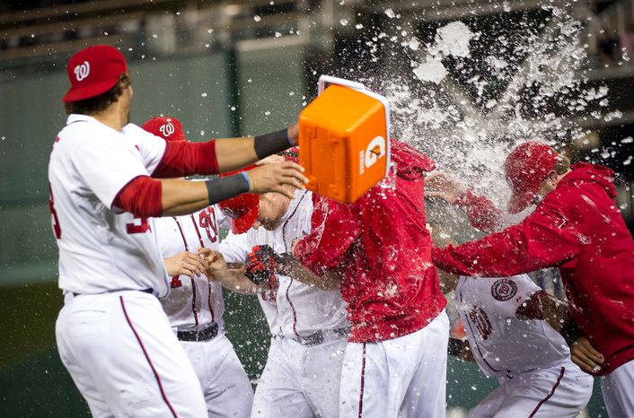 Washington Nationals 3B Chad Tracy (center) is doused in ice water Aug. 20, 2012, by teammate Michael Morse (left) after his game-winning RBI single in the Nationals' 5-4, 13-inning home victory over the Atlanta Braves. (Rod Lamkey Jr./The Washington Times) (Rod Lamkey Jr./The Washington Times)