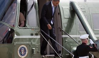 President Obama exits Marine One on Aug. 21, 2012, at Andrews Air Force Base, Md., before boarding Air Force One for a flight to Columbus, Ohio. (Associated Press)