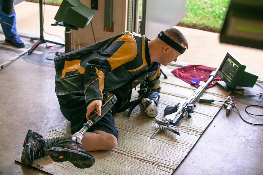 Sgt. 1st Class Josh Olson takes a break between shots at Fort Benning's Wagner Range. In addition to competing in the Paralympics, Olson is an instructor for the Army's Marksmanship Unit. (Andrew S. Geraci)