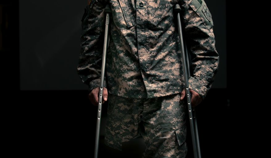 Sgt. 1st Class Josh Olson lost his right leg after being hit by an RPG in Tal Afar, Iraq, in October 2003. He's currently stationed at Fort Benning in Georgia as part of the Army's Marksmanship Unit. (Andrew S. Geraci)