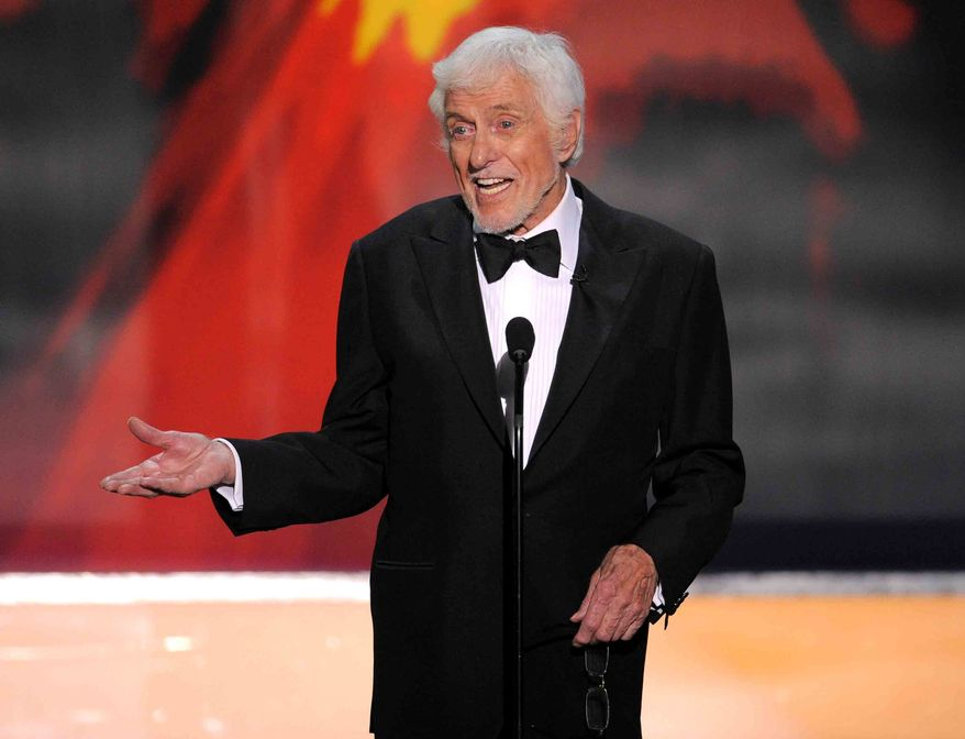 Actor Dick Van Dyke presents the Life Achievement Award to former co-star Mary Tyler Moore at the 18th annual Screen Actors Guild Awards in Los Angeles in January 2012. (AP Photo/Mark J. Terrill)