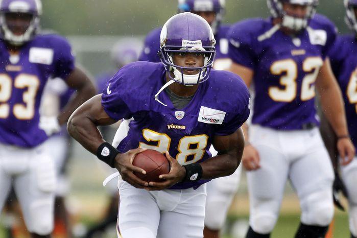 ** FILE ** Minnesota Vikings running back Adrian Peterson. (AP Photo/The Star Tribune, Jerry Holt)