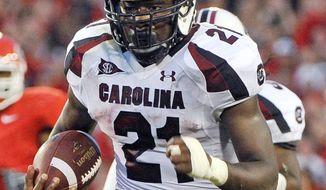 South Carolina running back Marcus Lattimore rushed for 818 yards in 2011 despite missing half the season. (AP Photo/John Amis, File)