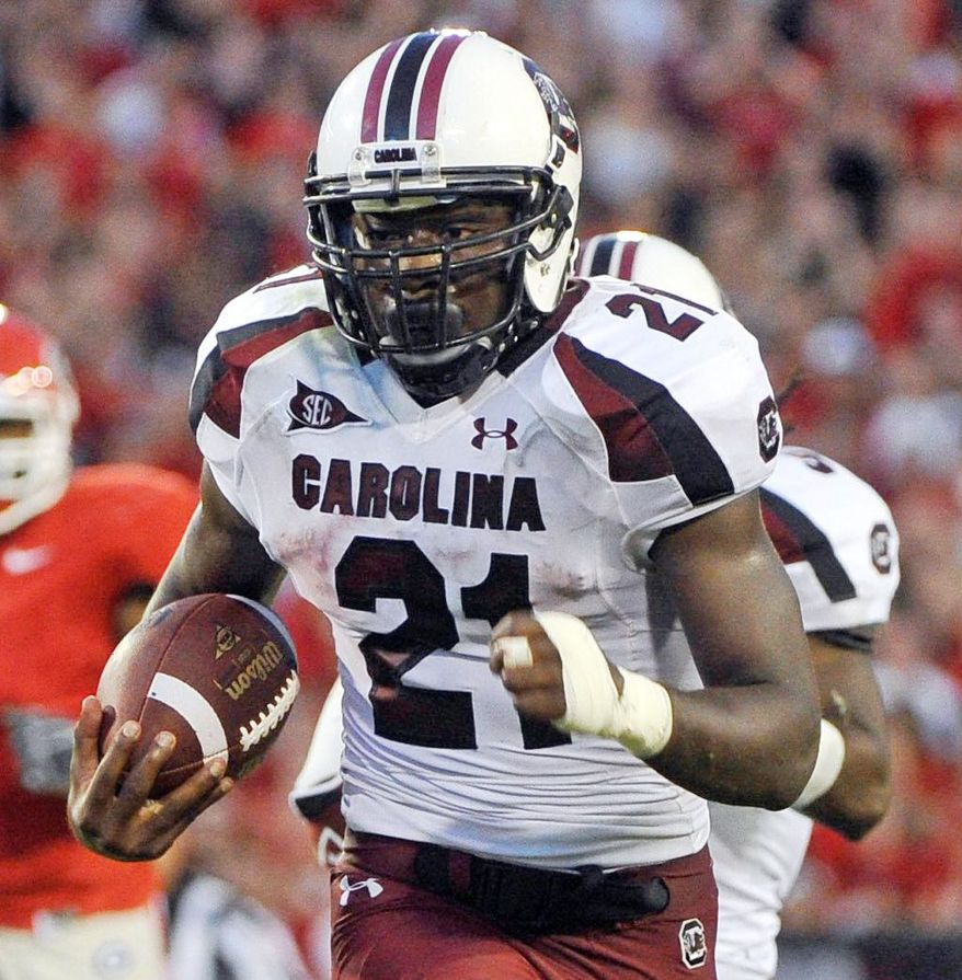 South Carolina running back Marcus Lattimore rushed for 818 yards in 2011 despite missing half the season. (AP Photo/John Amis, File)