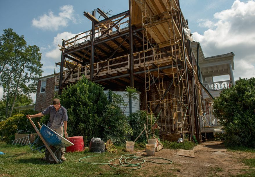 Dean Hinnant is among those working on the historic Cuckoo house, which saw its four chimneys crumble during the 5.8-magnitude earthquake that shook Mineral, Va., last August. (Andrew Harnik/The Washington Times)