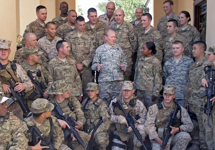 U.S. Army Gen. Martin Dempsey, chairman of the Joint Chiefs of Staff, talks to American service members with the International Security Assistance Forces in Kabul, Afghanistan, on Monday, Aug. 20, 2012. (AP Photo/D. Myles Cullen, Department of Defense)