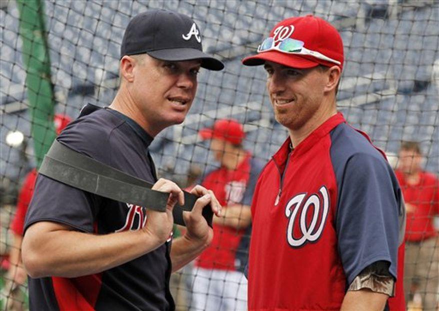Chipper Jones and Adam LaRoche (Associated Press)