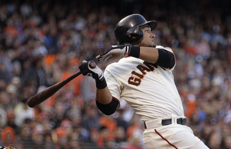 FILE - This July 14, 2012 file photo shows San Francisco Giants' Melky Cabrera swinging for an RBI single off Houston Astros' Lucas Harrell in the fifth inning of a baseball game in San Francisco. Cabrera has been suspended for 50 games without pay after testing positive for testosterone. The commissioner's office says the suspension is effective immediately. Major League Baseball said on Wednesday, Aug. 15, 2012,  that Cabrera tested positive for the banned performance-enhancing substance, which violates MLB's joint drug prevention and treatment program.(AP Photo/Ben Margot, File)