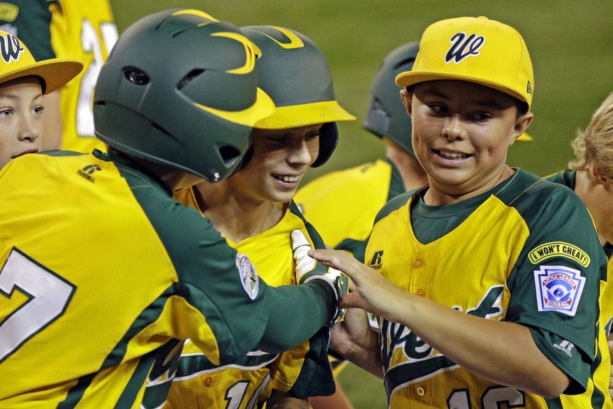 Petaluma, Calif.'s Hance Smith, center, is greeted by Blake Buhrer, left, and Andrew White, right, after hitting a three-run home run off Fairfield, Conn., pitcher Matt Kubel in the third inning of an elimination baseball game at the Little League World Series tournament in South Williamsport, Pa., Tuesday, Aug. 21, 2012. Petaluma won 5-0. (AP Photo/Gene J. Puskar)