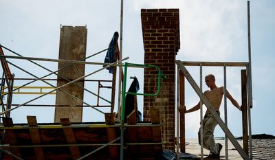Austin Wright works on the roof of the historic Cuckoo house, built by the Pendleton family in 1819 just outside Mineral Va., according to contractors on site, will take approximately one million dollars to repair, Cuckoo, Va., Tuesday, August 21, 2012. (Andrew Harnik/The Washington Times)
