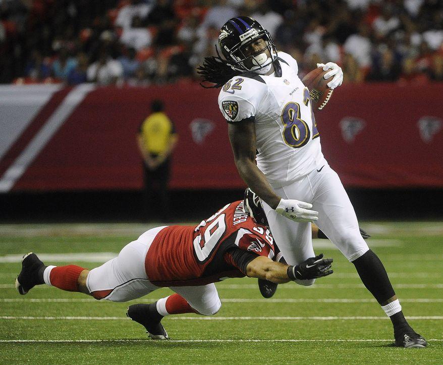 Baltimore Ravens wide receiver Torrey Smith (82) runs against Atlanta Falcons defensive back Shann Schillinger (39) during the first half of an NFL preseason football game, Thursday, Aug. 9, 2012, in Atlanta. (AP Photo/John Amis)