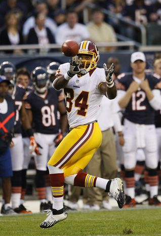 Redskins tight end Niles Paul had four catches, one for a  touchdown, Saturday at Chicago after grading out well as a blocker in the exhibition opener. (AP Photo/Charles Rex Arbogast)