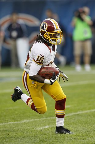 Washington Redskins wide receiver Brandon Banks (16) runs with the ball in the first half of an NFL preseason football game against the Chicago Bears in Chicago, Saturday, Aug. 18, 2012. (AP Photo/Charles Rex Arbogast)