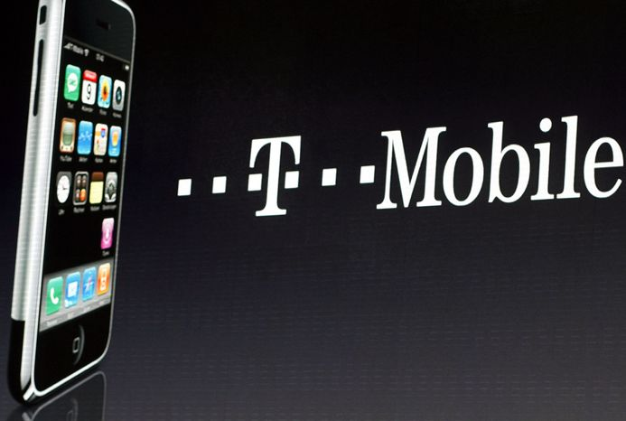 FILE- In this Wednesday Sept. 19, 2007 file photo, an iPhone is displayed next to a T-Mobile sign, in Berlin. Unlimited wireless data is back. After sliding off the menu of cellphone plans, data plans with no caps are making a comeback at smaller wireless companies trying to compete with AT&T and Verizon. T-Mobile USA, the nation's fourth-largest cellphone company, said Wednesday, Aug. 22, 2012, that it will start selling an unlimited-data plan again on Sept. 5, (AP Photo/Markus Schreiber, File)