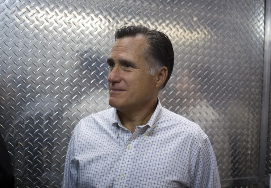 Republican presidential candidate Mitt Romney rides in an elevator to attend a fundraising event in Little Rock, Ark., on Aug. 22, 2012. (Associated Press)