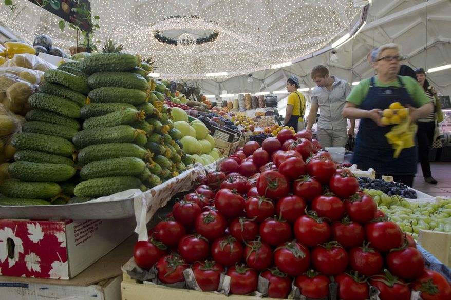 Vendors wait for customers at a Moscow market on Wednesday, Aug. 22, 2012, the day on which Russia joined the World Trade Organization. (AP Photo/Misha Japaridze)